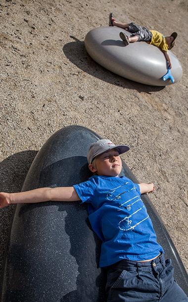 Kids on Pendeen Pebbles Cast Concrete pebble seats