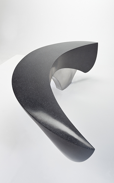 Highly polished sculptural seating by Ben Barrell