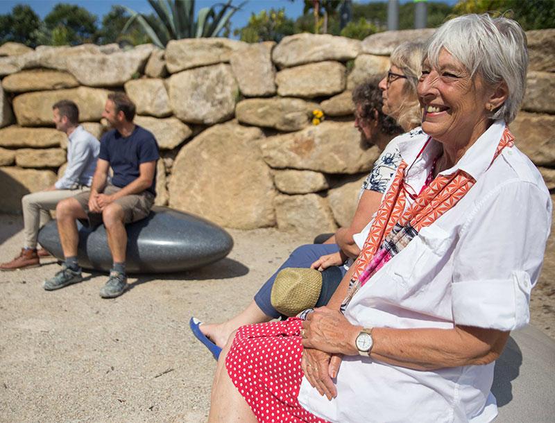 People enjoying sitting on Pebble Seats