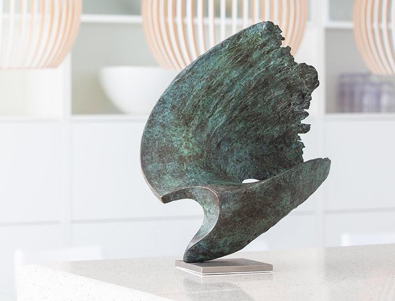 Bronze wave sculpture by ben barrell